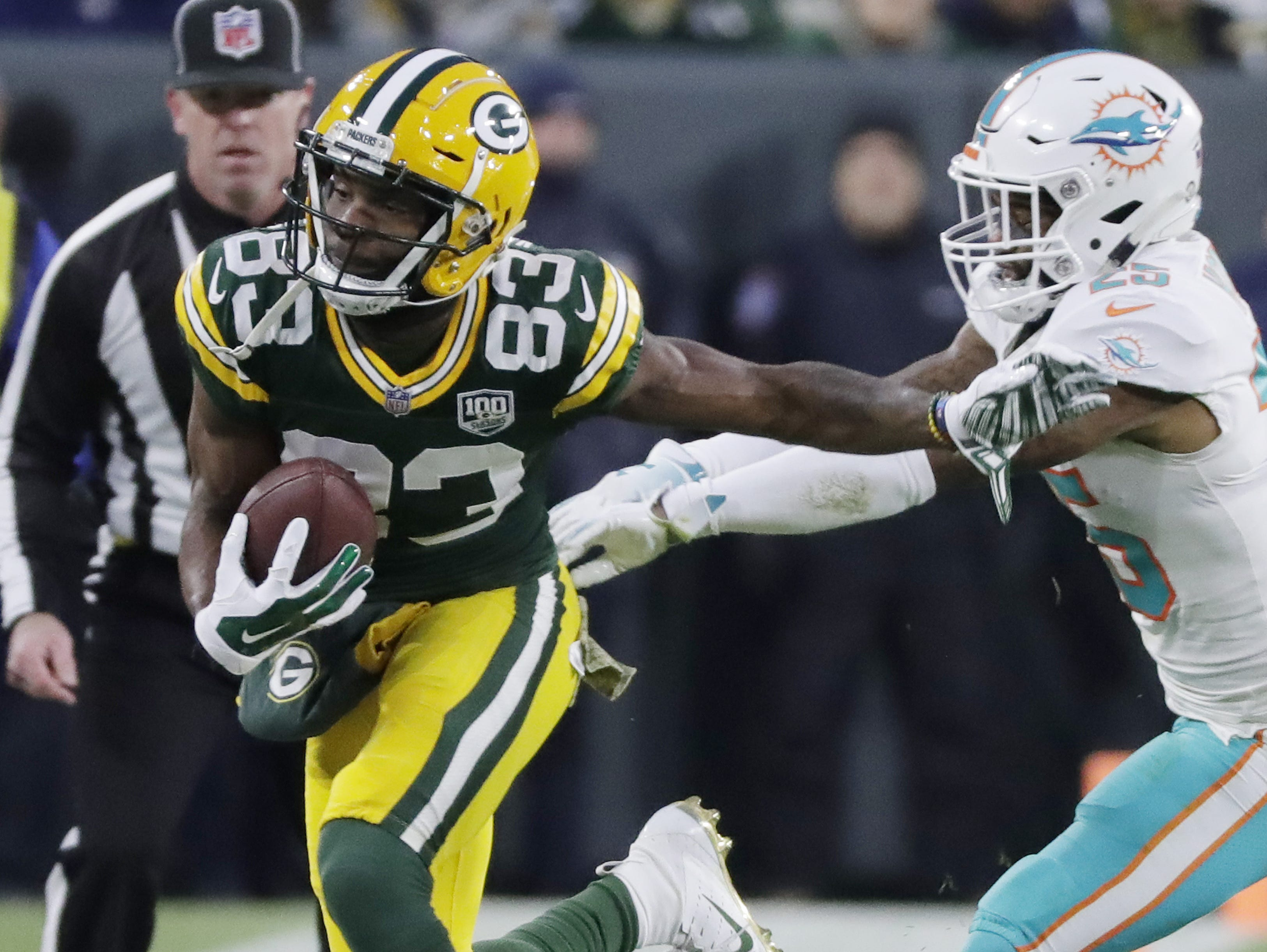 Green Bay Packers wide receiver Marquez Valdes-Scantling (83) is pushed out of bounds after a catch by Miami Dolphins cornerback Xavien Howard (25) in the second quarter at Lambeau Field on Sunday, November 11, 2018 in Green Bay, Wis. Adam Wesley/USA TODAY NETWORK-Wisconsin