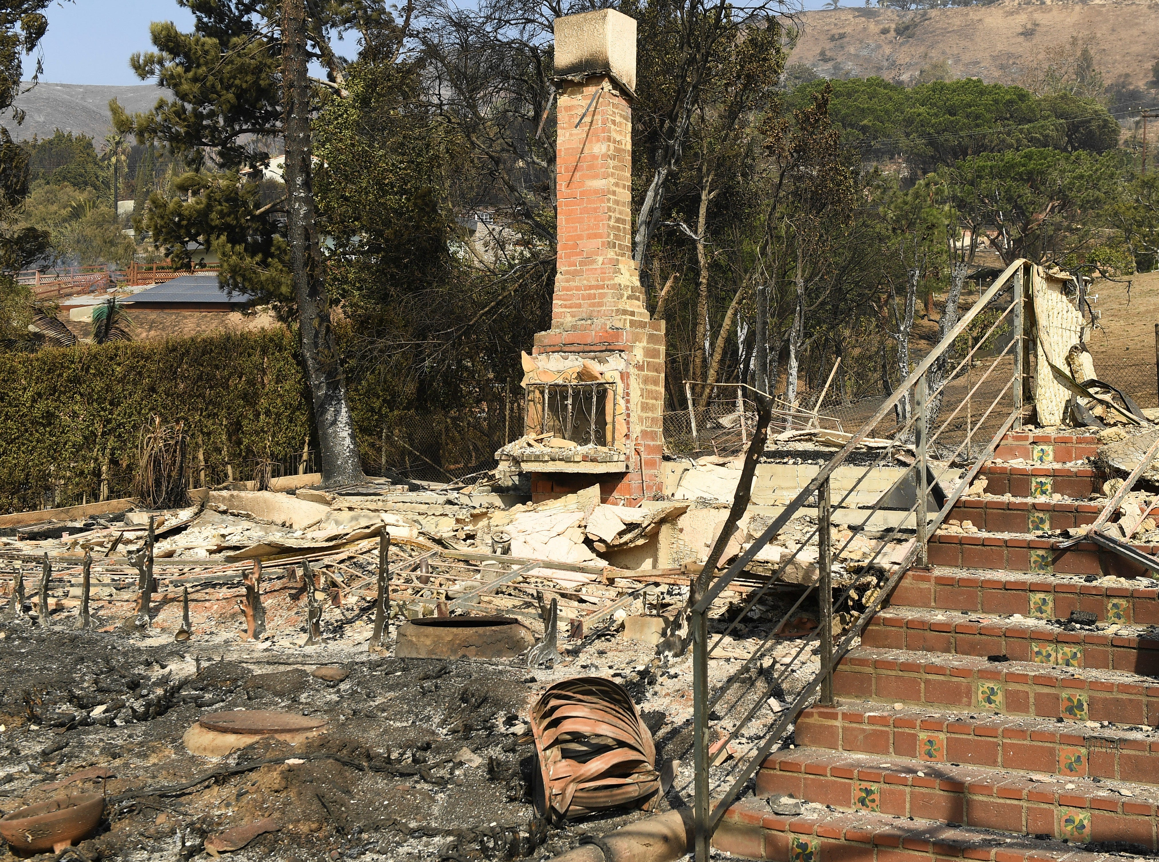 The remains of a home on Harvester Road in Malibu. The resident of the home found a piece of family jewelry digging through the ruins of him home. The neighborhood was over run by the Woosley Fire which has consumed over 70,000 acres as of 11/10/2018.
