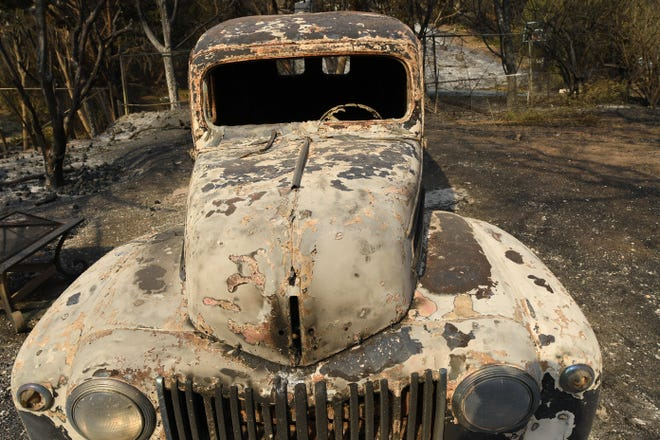 The burned out remains of an antique car on Harvester Road in Malibu. The neighborhood was over run by the Woosley Fire which has consumed over 70,000 acres as of 11/10/2018.