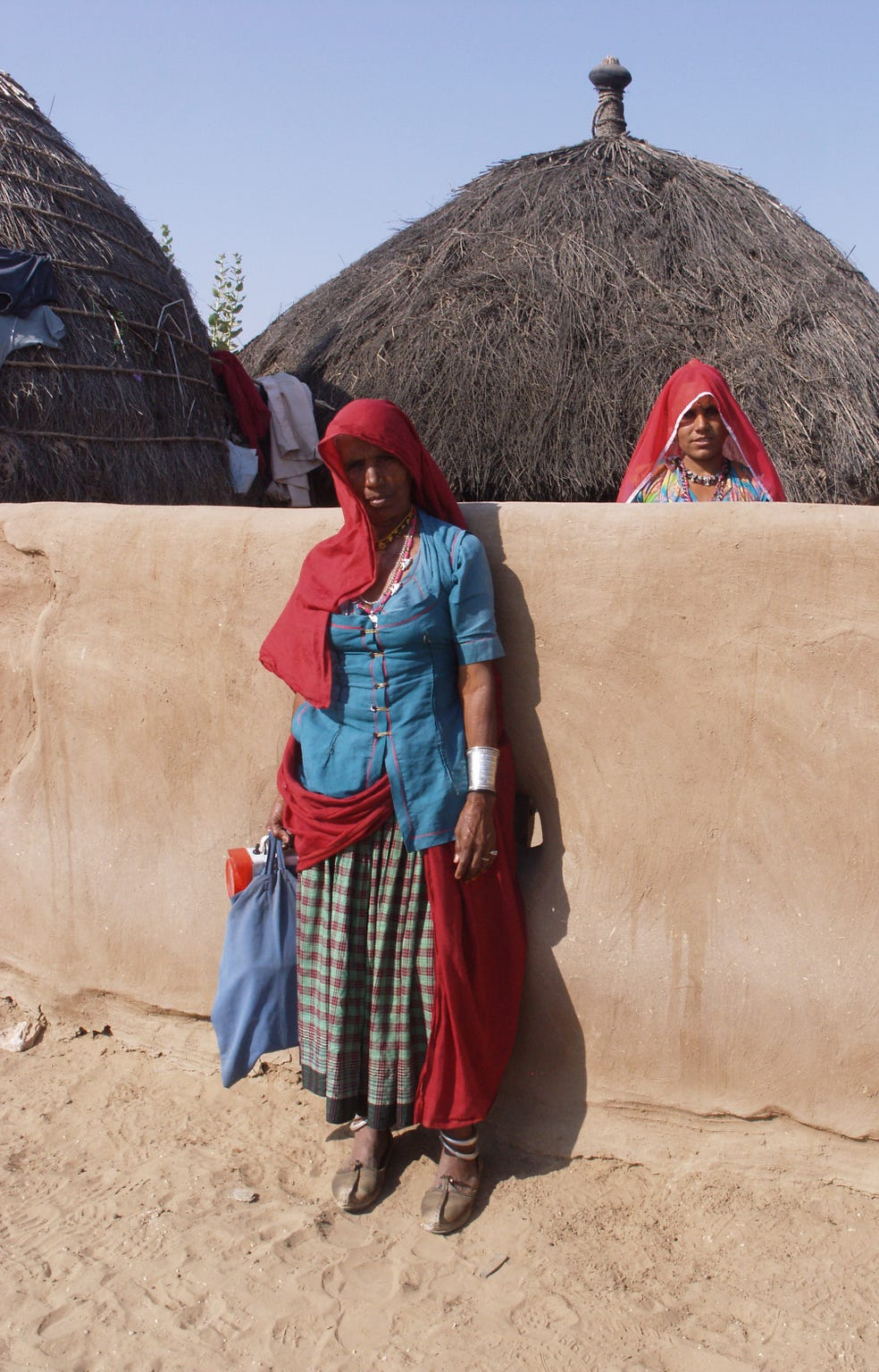 Thatched roofs and adobe walls in India's Thar Desert