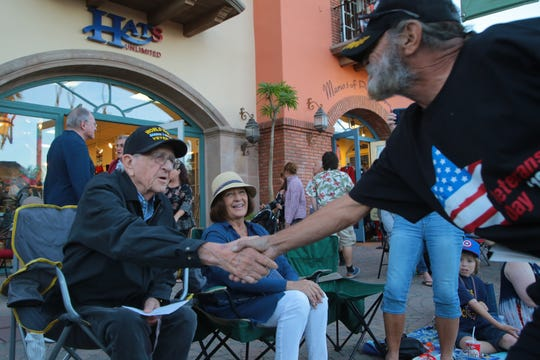 World War II veteran Ernest Mosher, left, attends the annual Palm Springs Veterans Day Parade, Sunday, November 11, 2018. Veterans from all wars can find help with PTSD and depression through peer counseling services offered through the VA.
