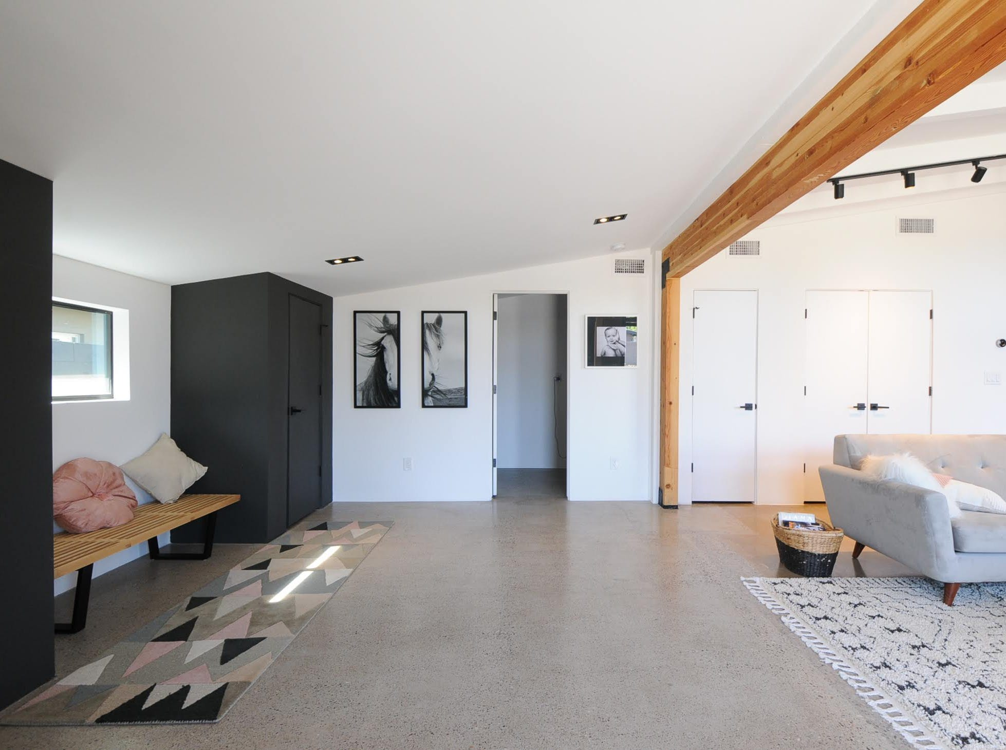 Storage, seating, art and open space greet visitors at the Haver home Gwilliam and Peterson own.