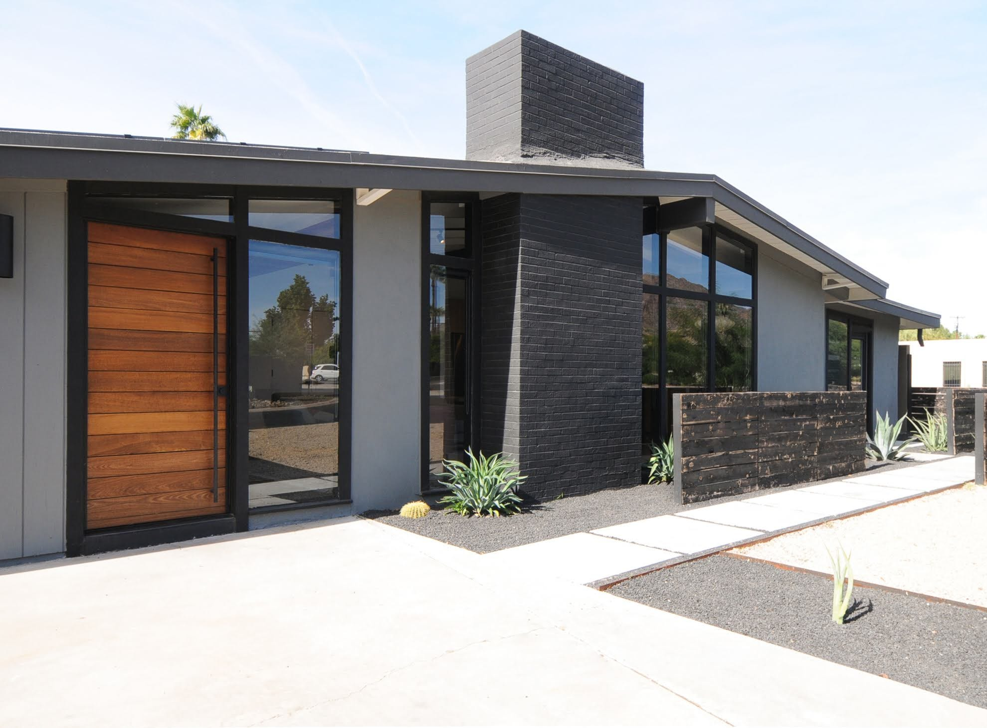 Black steel trim, an oversized front door and rustic wood show visitors what they may expect once inside the Arcadia-area Haver home.