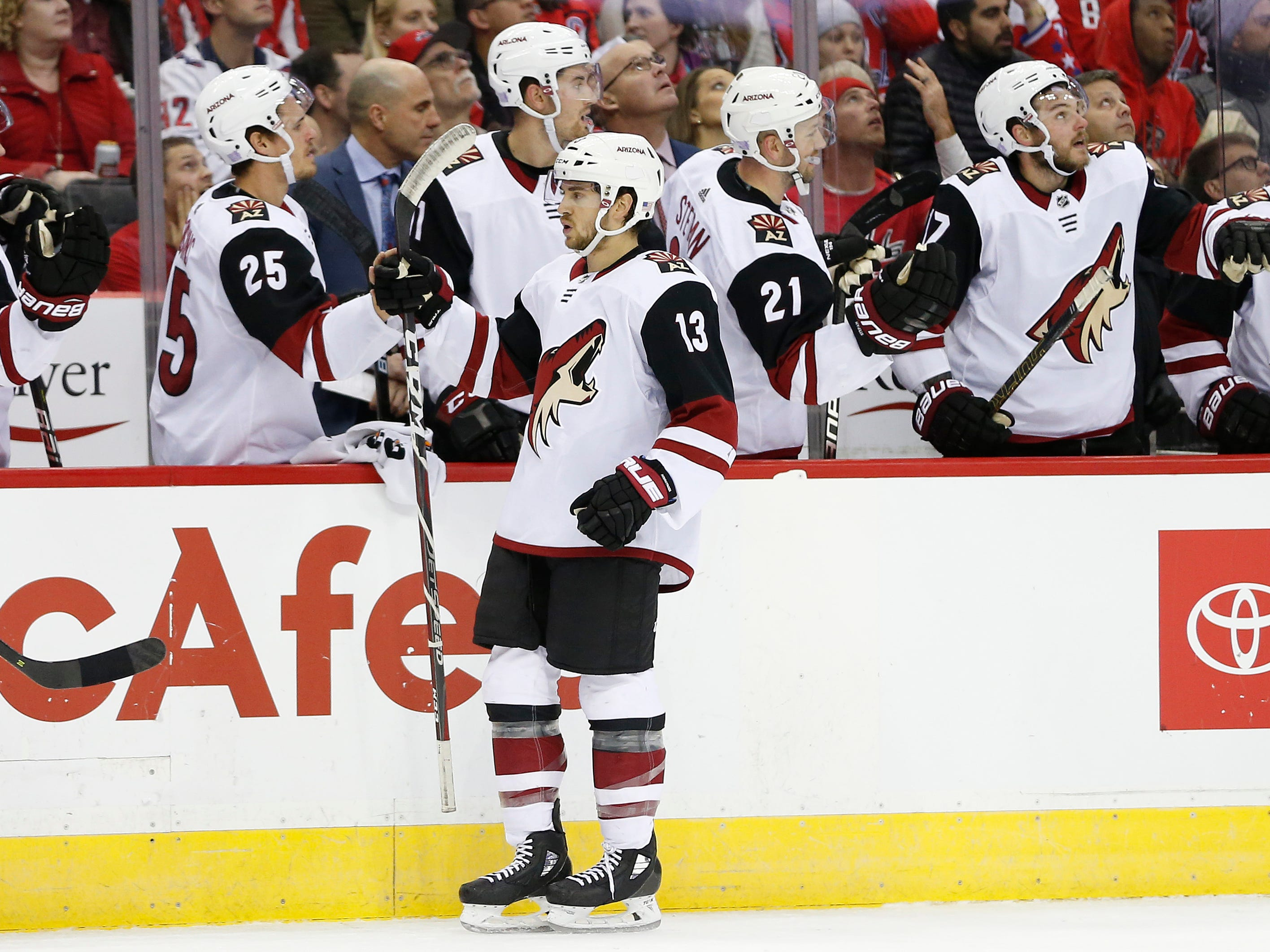 Nov 11, 2018; Washington, DC, USA; Arizona Coyotes center Vinnie Hinostroza (13) celebrates with teammates after scoring a goal during the first period against the Washington Capitals at Capital One Arena. Mandatory Credit: Amber Searls-USA TODAY Sports