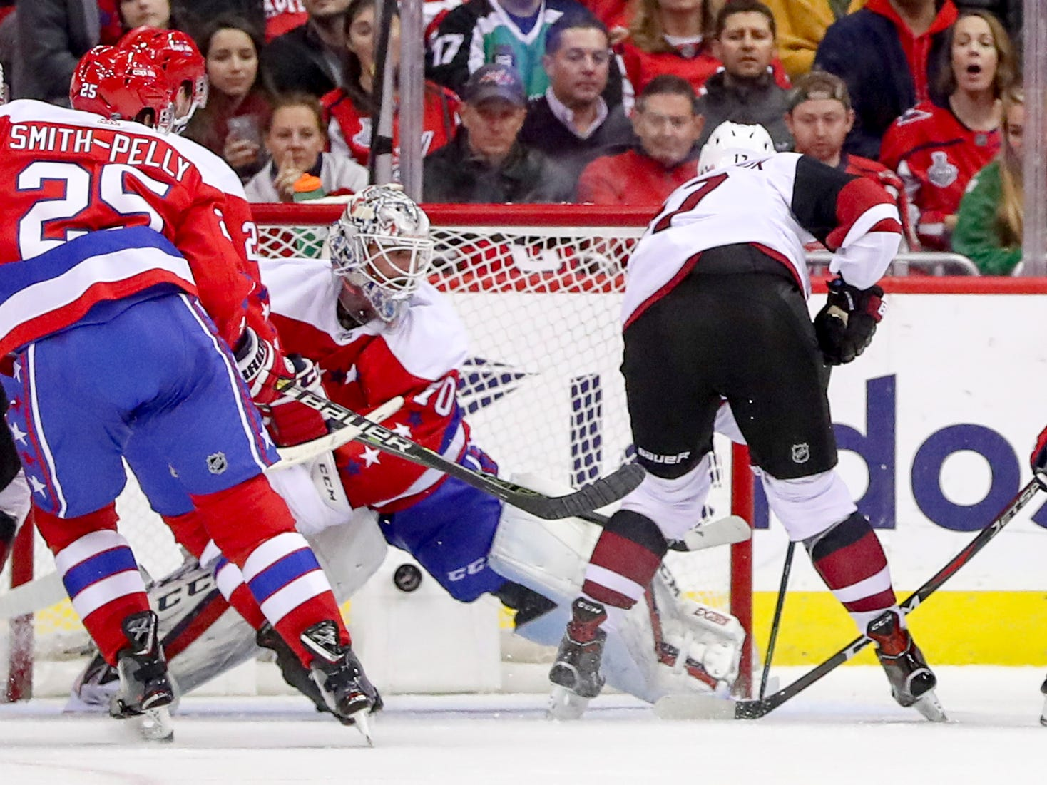 Arizona Coyotes center Alex Galchenyuk, right, scores against Washington Capitals goaltender Braden Holtby in the second period of an NHL hockey game, Sunday, Nov. 11, 2018 in Washington. (AP Photo/Andrew Harnik)