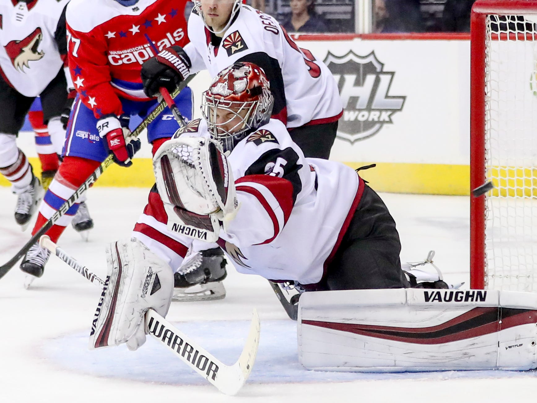 Washington Capitals center Nicklas Backstrom scores against Arizona Coyotes goaltender Darcy Kuemper in the second period of an NHL hockey game, Sunday, Nov. 11, 2018 in Washington. (AP Photo/Andrew Harnik)