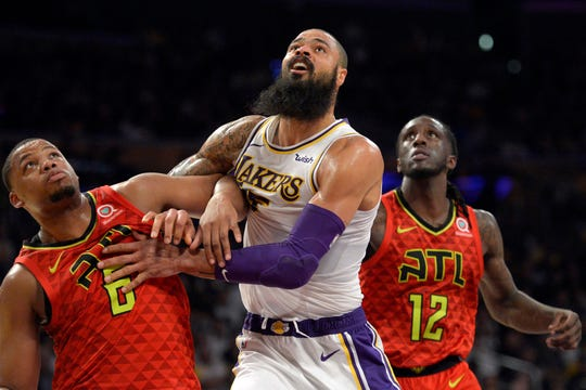 Lakers center Tyson Chandler works against Hawks forward Omari Spellman (6) and and Taurean Prince (12)  during the second half of a game Dec. 2 at Staples Center.