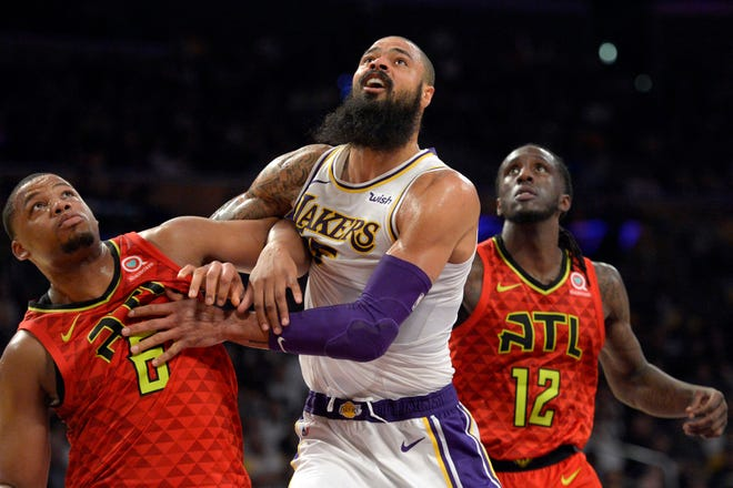 Lakers center Tyson Chandler works against Hawks forward Omari Spellman (6) and forward Taurean Prince (12) during the second half of a game at Staples Center.