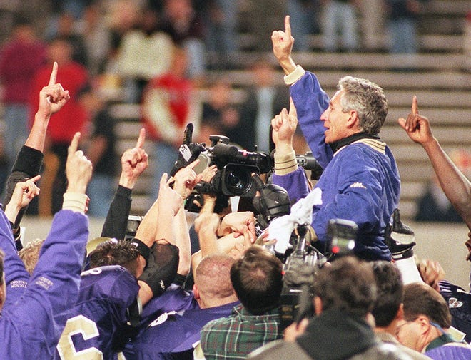 Tucson Sabino head coach Jeff Scurran is carried onto field by his team after the Sabercats' victory over Avondale Agua Fria in the 4A title game at Sun Devil Stadium on Friday, Dec. 11, 1998.