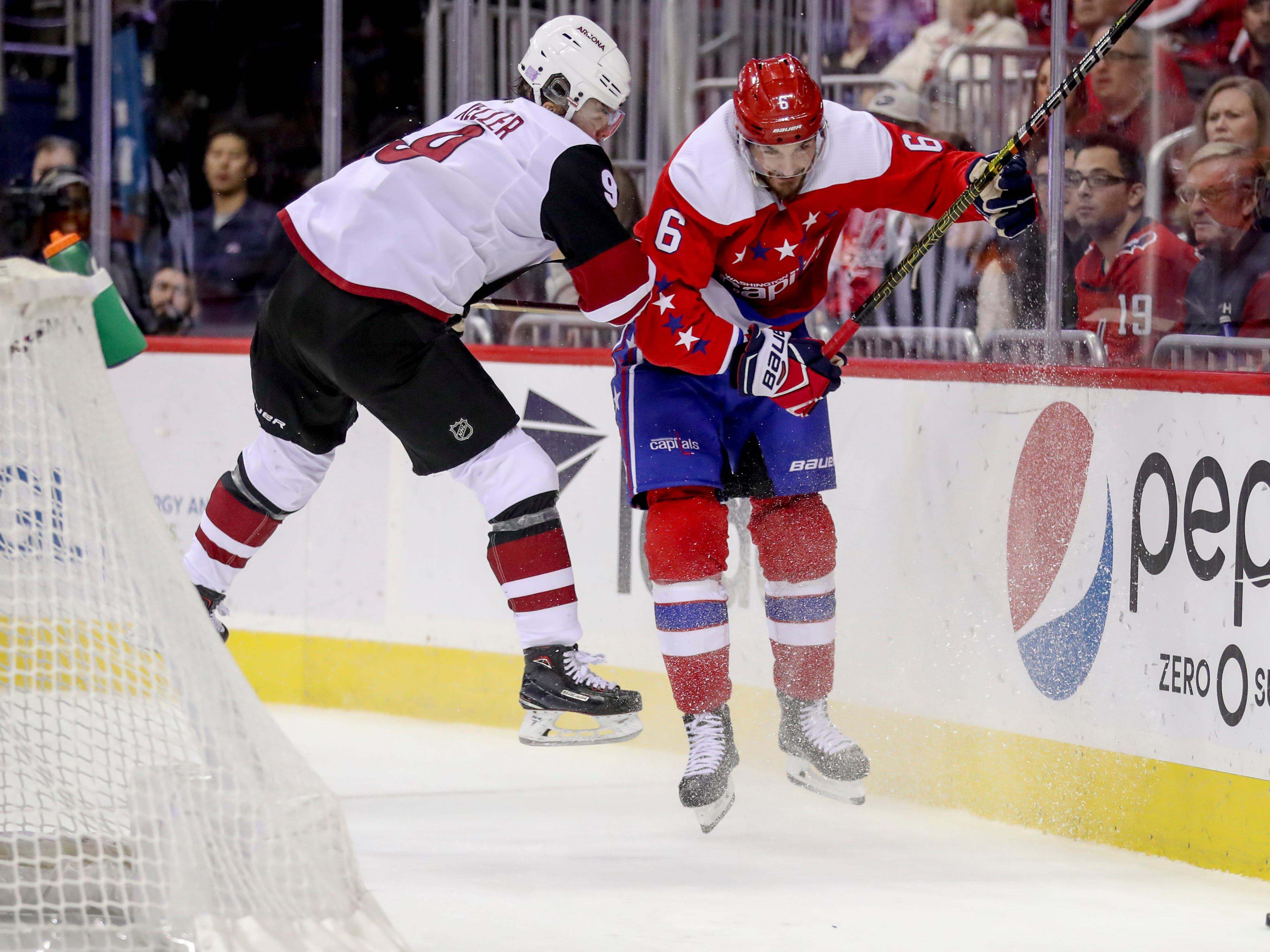 Arizona Coyotes center Clayton Keller and Washington Capitals defenseman Michal Kempny collide in the third period of an NHL hockey game between the Washington Capitals and the Arizona Coyotes, Sunday, Nov. 11, 2018 in Washington. The Coyotes won 4-1. (AP Photo/Andrew Harnik)