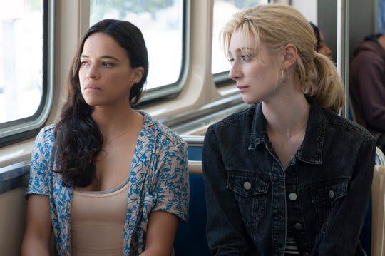 """Michelle Rodriguez (left) and Elizabeth Debicki star in """"Widows."""""""