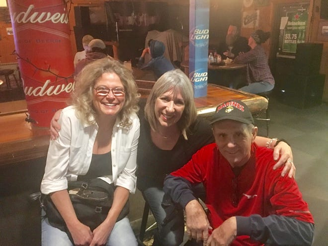 Marine Mike Petrone and his wife Carrie  join Karina Bland every year on Nov. 10 for the Marine Corps birthday at the Silver Pony Bar & Grill in south Phoenix.
