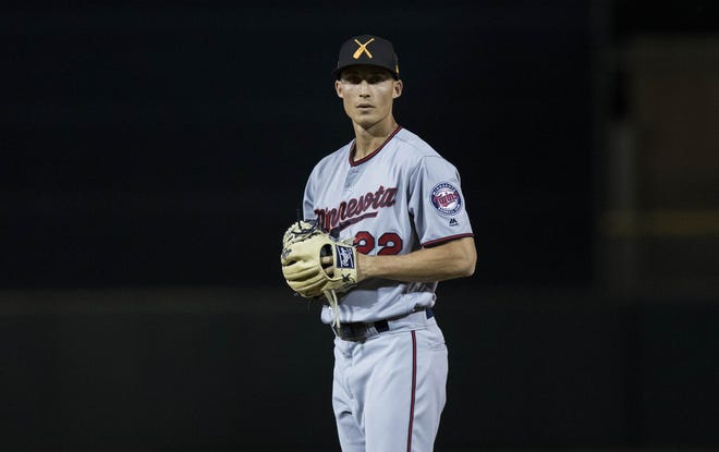 Twins pitching prospect Griffin Jax looks for a signal during an Arizona Fall League game against the Scottsdale Scorpions.