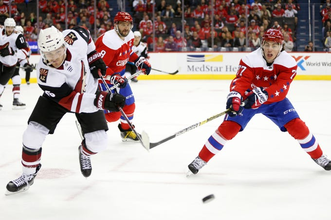 Nov 11, 2018; Washington, DC, USA; Washington Capitals right wing T.J. Oshie (77) battles for the puck with Arizona Coyotes right wing Christian Fischer (36) during the first period at Capital One Arena. Mandatory Credit: Amber Searls-USA TODAY Sports