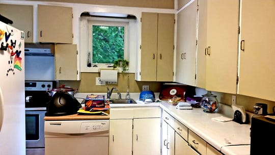 A before photo of The Harbor's recently renovated kitchen. Cabinets and draws did not close and separate refrigerator and freezers crowded the work space.