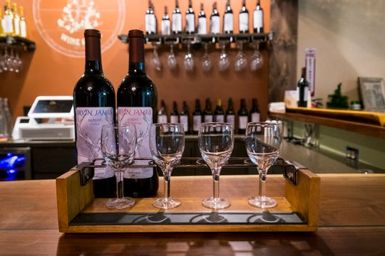 Mannina's Wine House in St. Clair offers wine flights, which allow customers to have smaller servings of four different wines. The wine house, located in Riverview Plaza in St. Clair, opened last week.