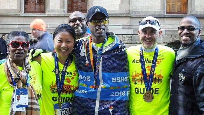 Wappingers Falls' Jonathan Brunot, center, poses with his guides and family at the New York City Marathon.