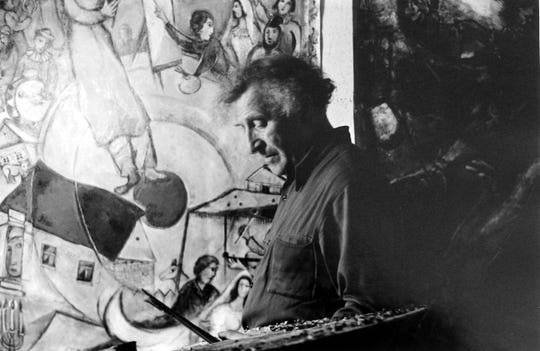 """Marc Chagall is show at the easel painting """"Liberation"""" in his studio in High Falls. The famous work of art now hangs in the Chagall Museum in France."""