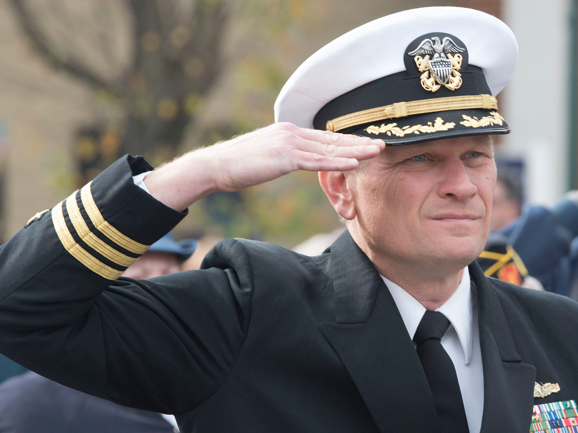 Commander Bruce Apgar  (Senior Naval Science Instructor at CASHS) salutes before his role as guest speaker during the ceremony. The Veterans Day Parade and ceremony to honor members of the military was held Monday, November 12, 2018 along Lincoln Way East and at Memorial Square.