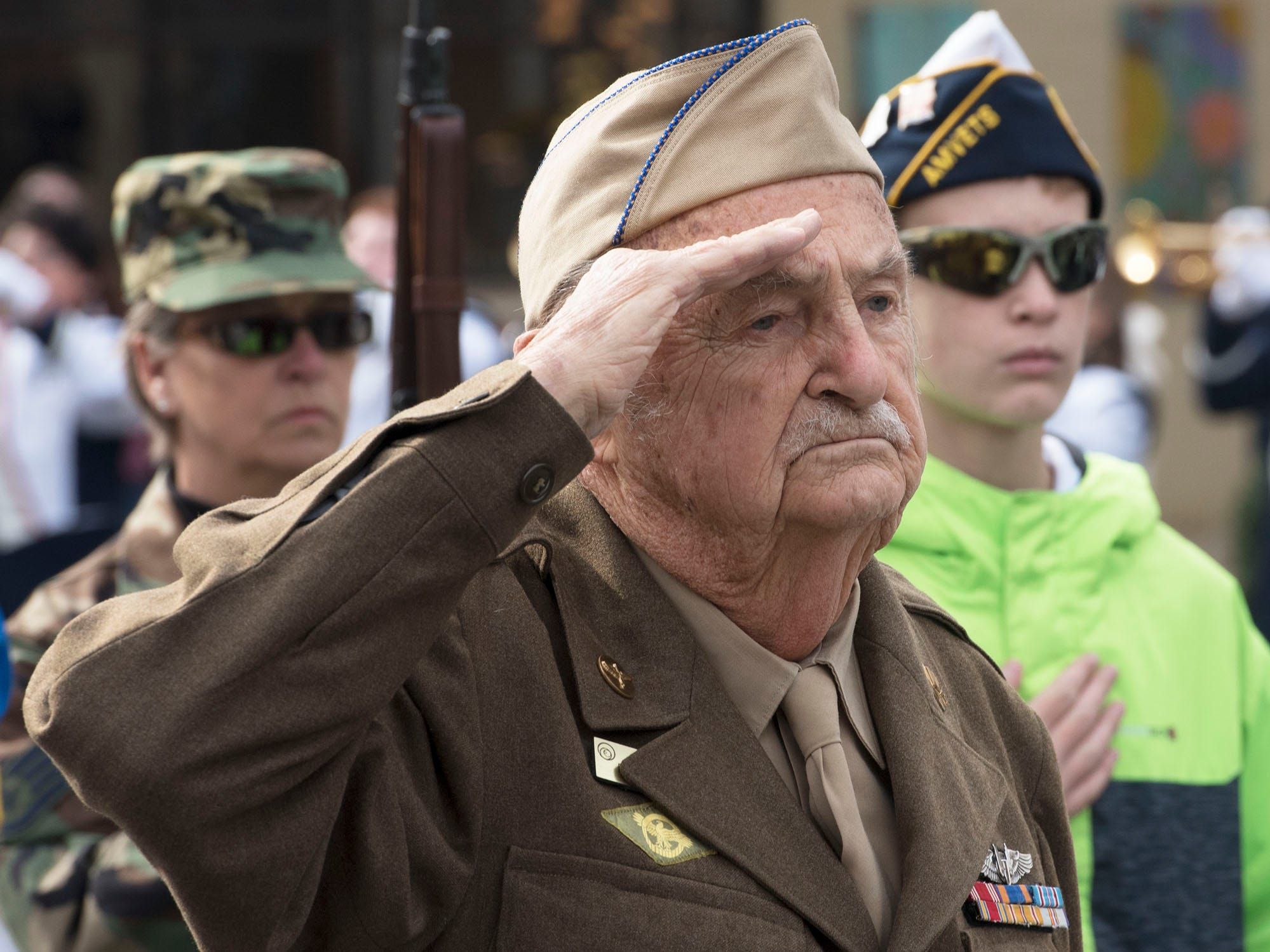 WWII Veteran and parade marshal David Demichei salutes during the ceremony. The Veterans Day Parade and ceremony to honor members of the military was held Monday, November 12, 2018 along Lincoln Way East and at Memorial Square.