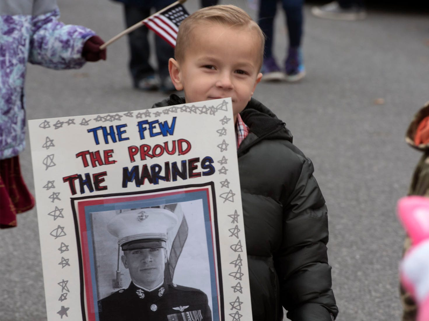 Mads Tingey, 5,   honors his uncle as he walks during a Veterans Day Parade sponsored by James Burd Elementary School, Shippensburg. Last year, Burd hosted its own parade because the Shippensburg parade was canceled. Now the event is becoming a tradition.
