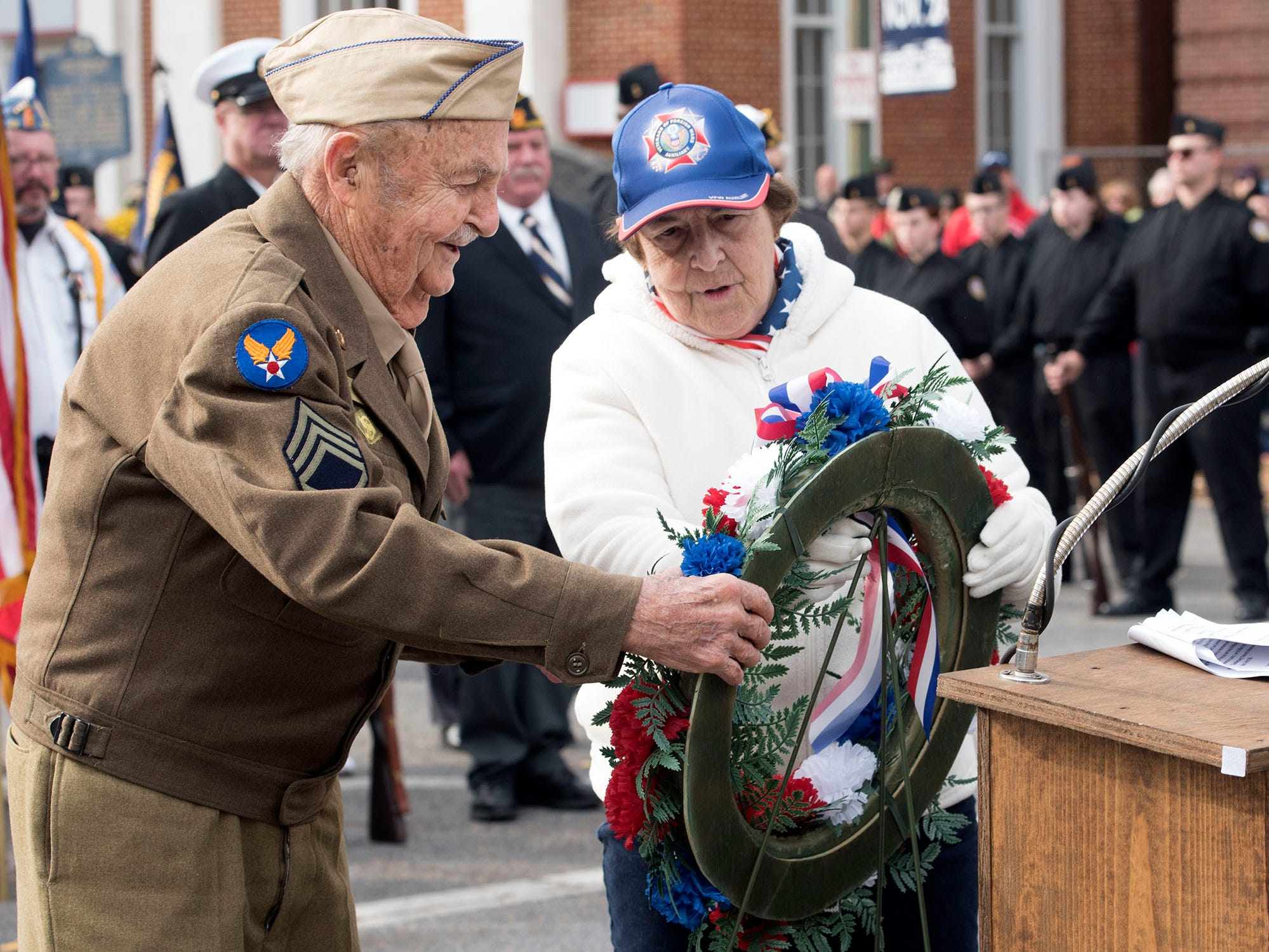 David Demichei and Julie Marker lay the wreath at Chambersburg Memorial Square. The Veterans Day Parade and ceremony to honor members of the military was held Monday, November 12, 2018 along Lincoln Way East and at Memorial Square.