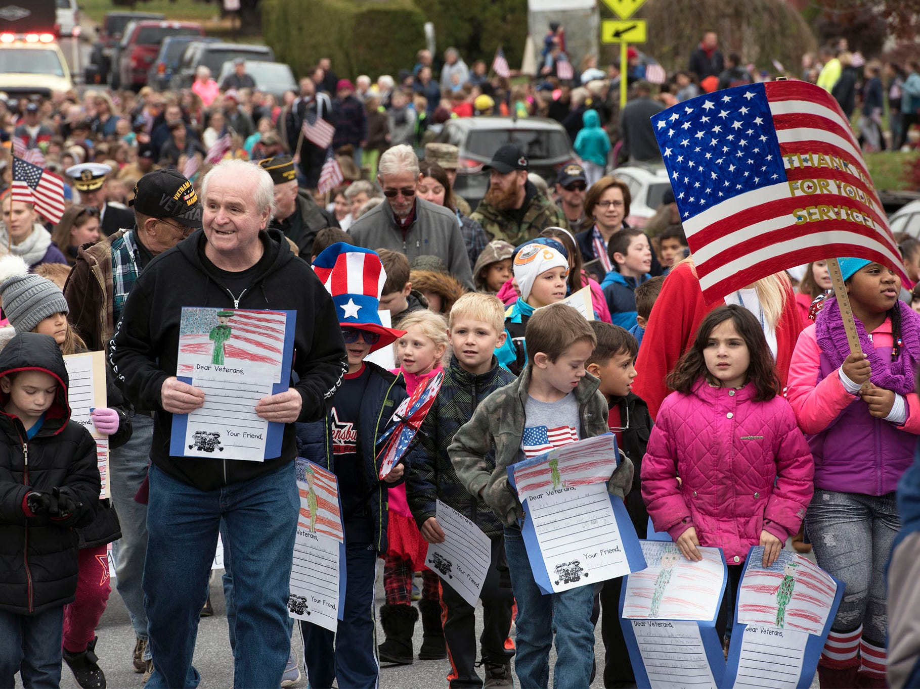 A crowd of veterans and students walk together during a Veterans Day Parade sponsored by James Burd Elementary School, Shippensburg. Last year, Burd hosted its own parade because the Shippensburg parade was canceled. Now the event is becoming a tradition.