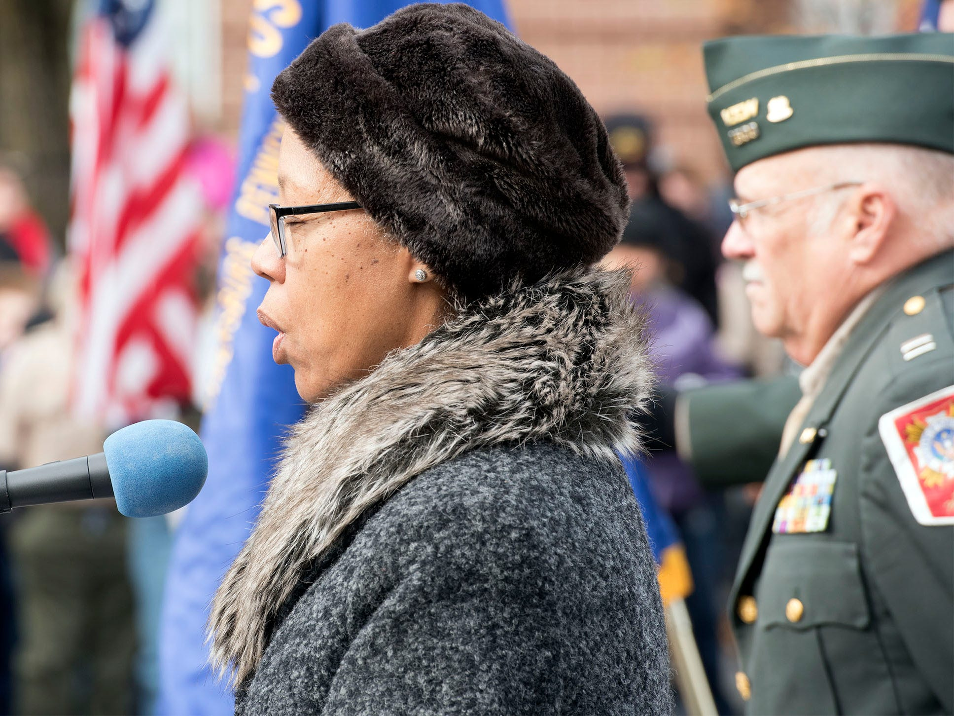Rev. Renata Harper says a prayer during the ceremony. The Veterans Day Parade and ceremony to honor members of the military was held Monday, November 12, 2018 along Lincoln Way East and at Memorial Square.