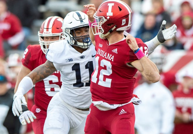 Penn State linebacker Micah Parsons (11) closes in on Indiana quarterback Peyton Ramsey (12) after he released a pass earlier this season. Parsons is primed to take on an increased role for PSU down the stretch.