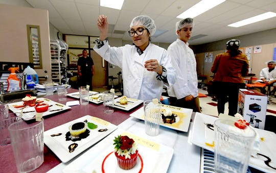 Hanover High School junior Izzy Oropeza puts a finishing touch on her dessert assignment in a culinary class at the school Friday, Nov. 9, 2018. The final entries were judged by fellow students. Bill Kalina photo