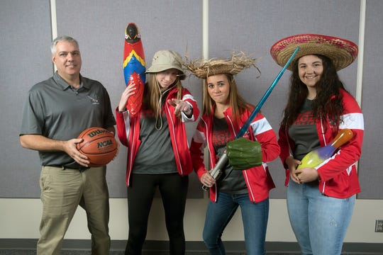 From the left, Coach Todd Askins, Arden Bealmear, Skyler West, and Emily Shearer, with the Bermudian Springs girls basketball team, pose during the 2018-19 GameTimePa YAIAA Winter Media Day Sunday November 11, 2018.