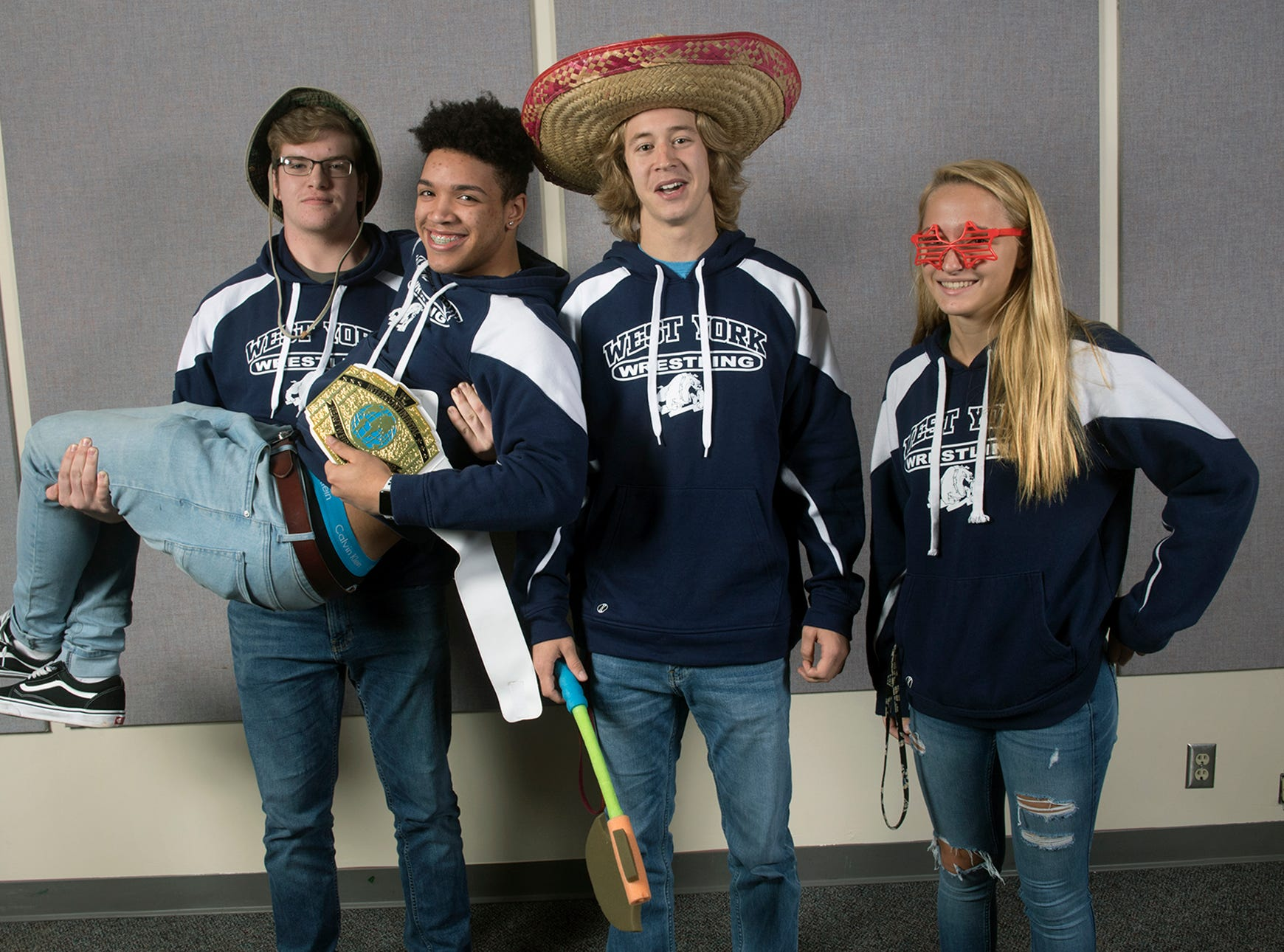 From the left, Frank Veloce, Claudio Cruz II, Luke Stine and Carly Gross, of the West York Area High School wrestling team, pose during the 2018-19 GameTimePa YAIAA Winter Media Day Sunday November 11, 2018.