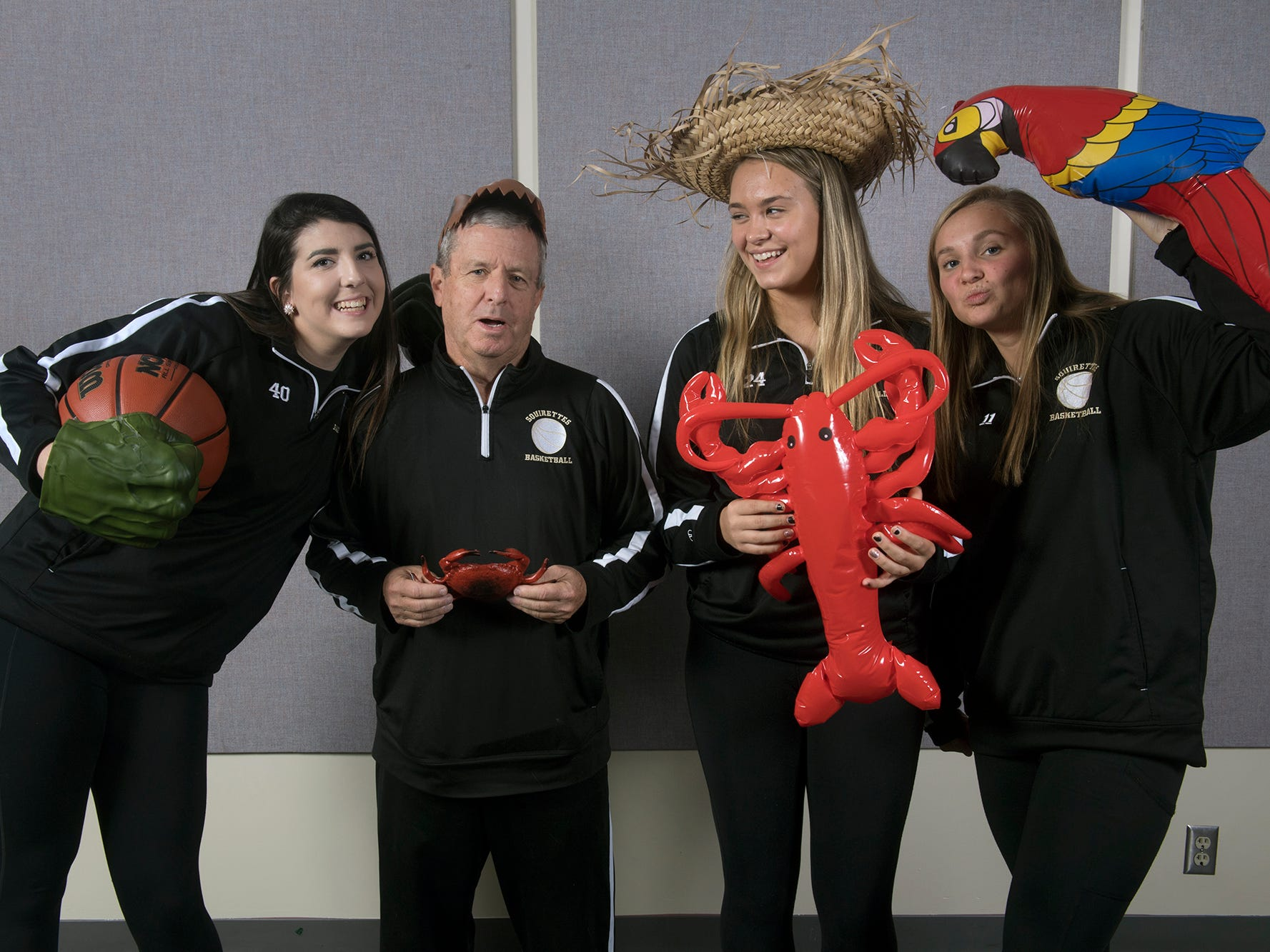From the left, Bradi Zumbrum, Coach Gerry Eckenrode, Colleen Anderson, and Riley Vingsen, with the Delone Catholic girls basketball team, pose during the 2018-19 GameTimePa YAIAA Winter Media Day Sunday November 11, 2018.