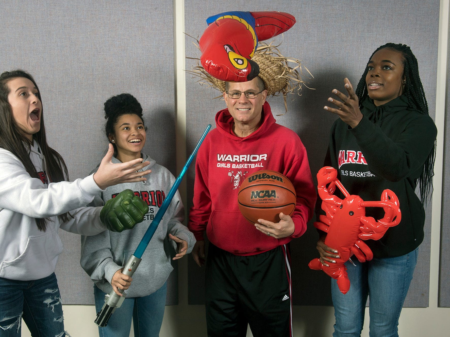From the left, Kelsey Gemmill, Jayla Galbreath, Dave Schreiner and Jaden Walker, with the Susquehannock girls basketball team, pose during the 2018-19 GameTimePa YAIAA Winter Media Day Sunday November 11, 2018.
