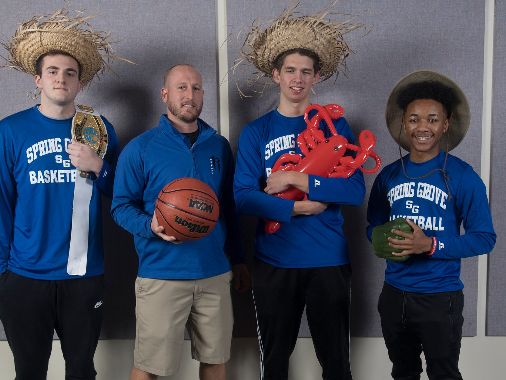 From the left, Jordan Bellamy, Ryan Eisenhart, Elijah Taylor, and Madison Moore, of the Spring Grove High School basketball team, during the 2018-19 GameTimePa YAIAA Winter Media Day Sunday November 11, 2018.