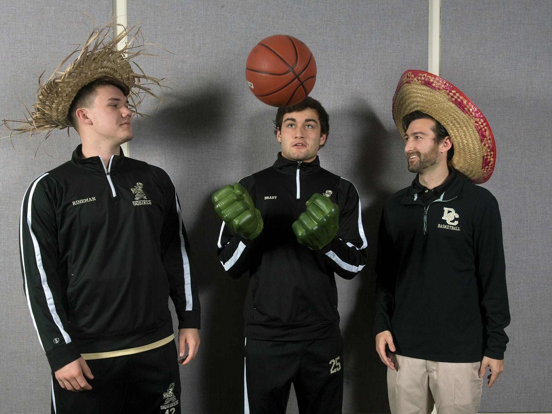 From the left, Matt Rineman, Evan Brady and Cory Brady, with the Delone Catholic basketball team, pose during the 2018-19 GameTimePa YAIAA Winter Media Day Sunday November 11, 2018.