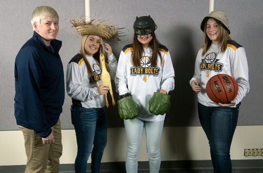 From the left, Coach Kelsey Wantz, Olivia Study, Ava Collins and Grace Midkiff, pose during the 2018-19 GameTimePa YAIAA Winter Media Day Sunday November 11, 2018.
