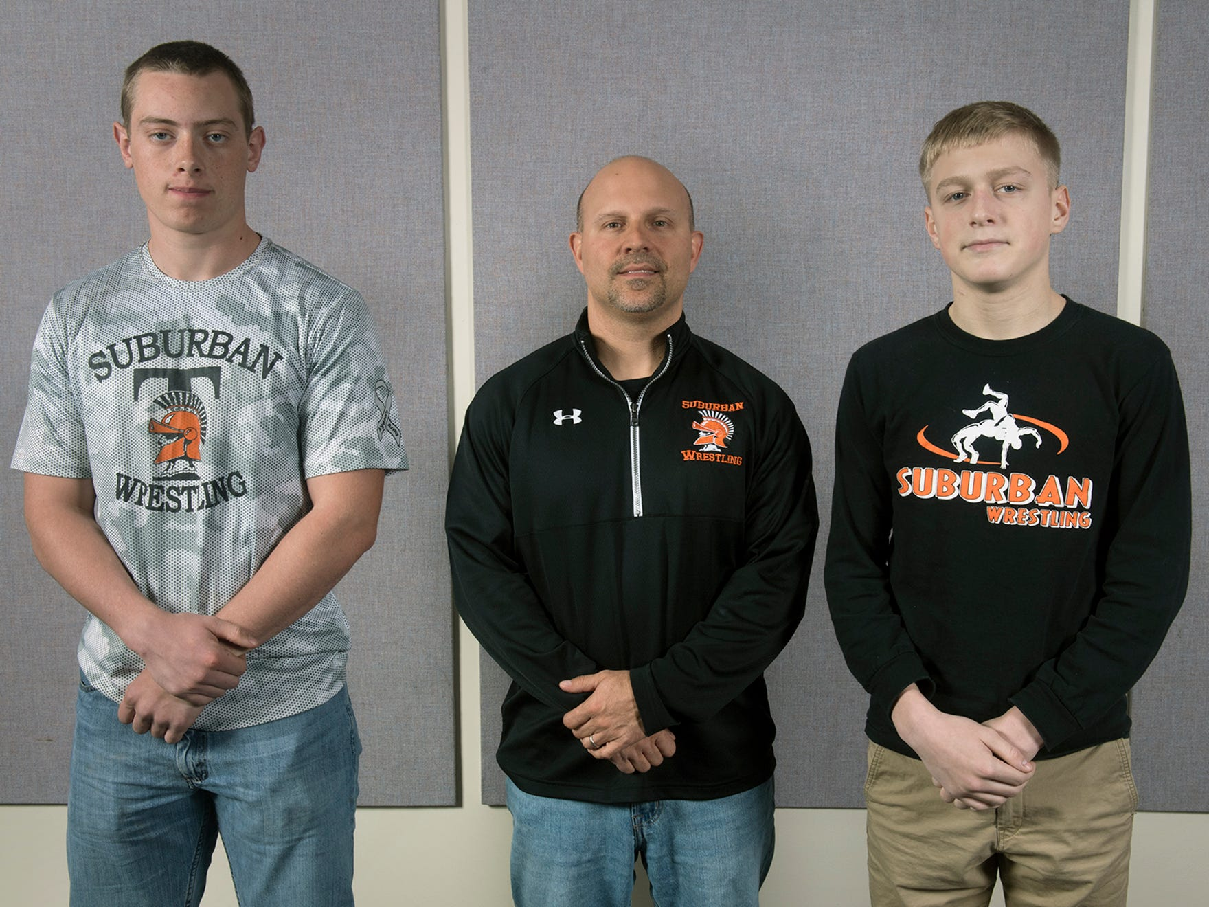 From the left, Andew Frey, Coach Brian Gentzyl, and Dylan Leik, of the York Suburban High School wrestling team, pose during the 2018-19 GameTimePa YAIAA Winter Media Day Sunday November 11, 2018.