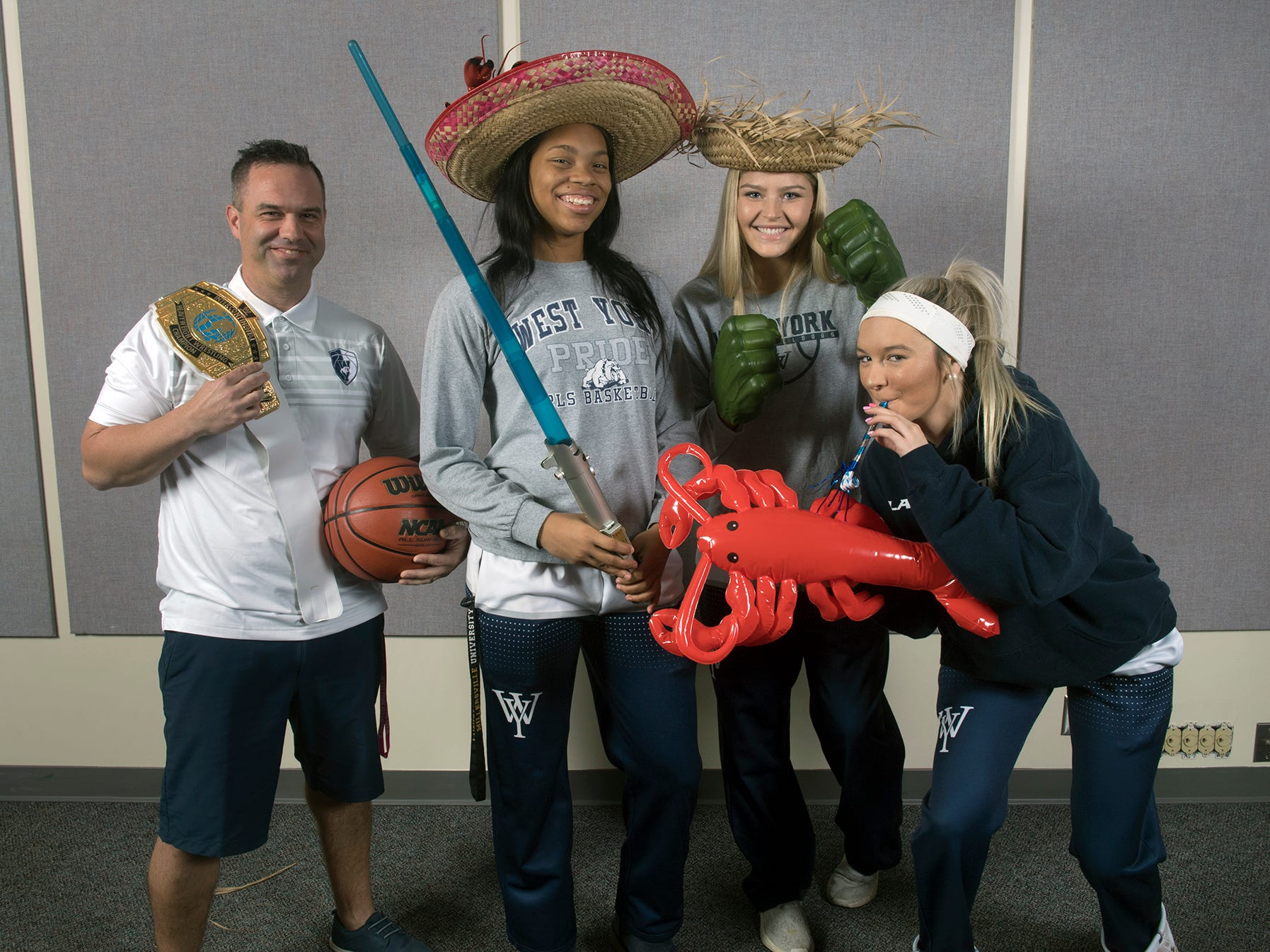 From the left, coach James Kunkle, Alayna Harris, Alyssa Zorbaugh and Makenna Hoffman, of the West York girls basketball team, pose during the 2018-19 GameTimePa YAIAA Winter Media Day Sunday November 11, 2018.
