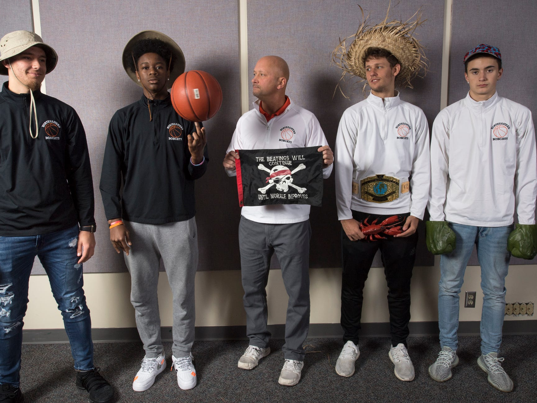 From the left, Zech Sanderson, Quay Mulbauh, Coach Jon Eyster, Nate Wilson and Adam Brodbeck, of the Northeastern High School boys basketball team, pose during the 2018-19 GameTimePa YAIAA Winter Media Day Sunday November 11, 2018.