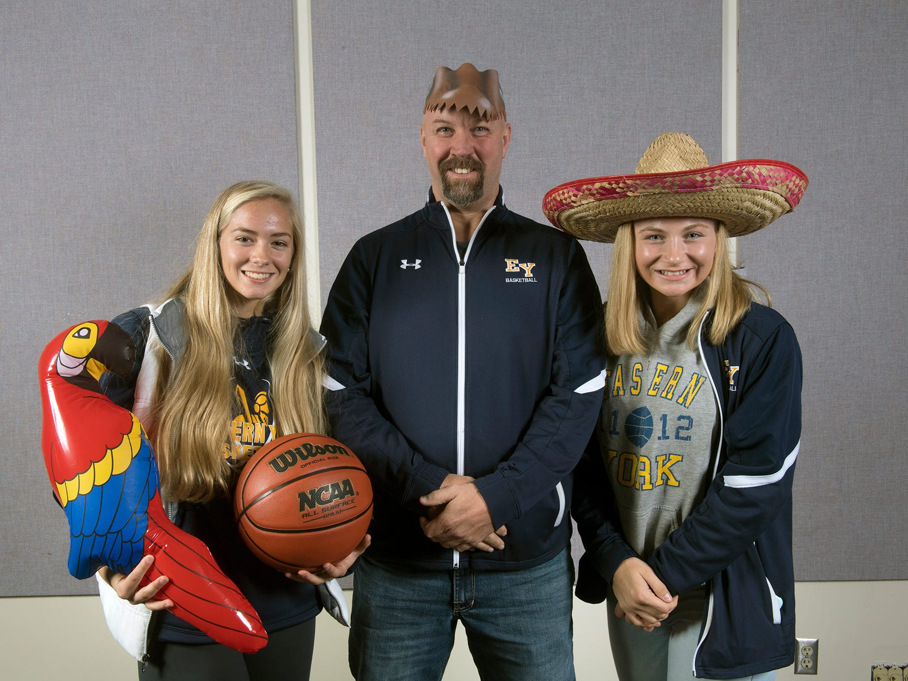 From the left, Addison Malone, Coach Brad Weaver, and Cassidy Arnold, with the Eastern York Sr. High School basketball team, pose during the 2018-19 GameTimePa YAIAA Winter Media Day Sunday November 11, 2018.