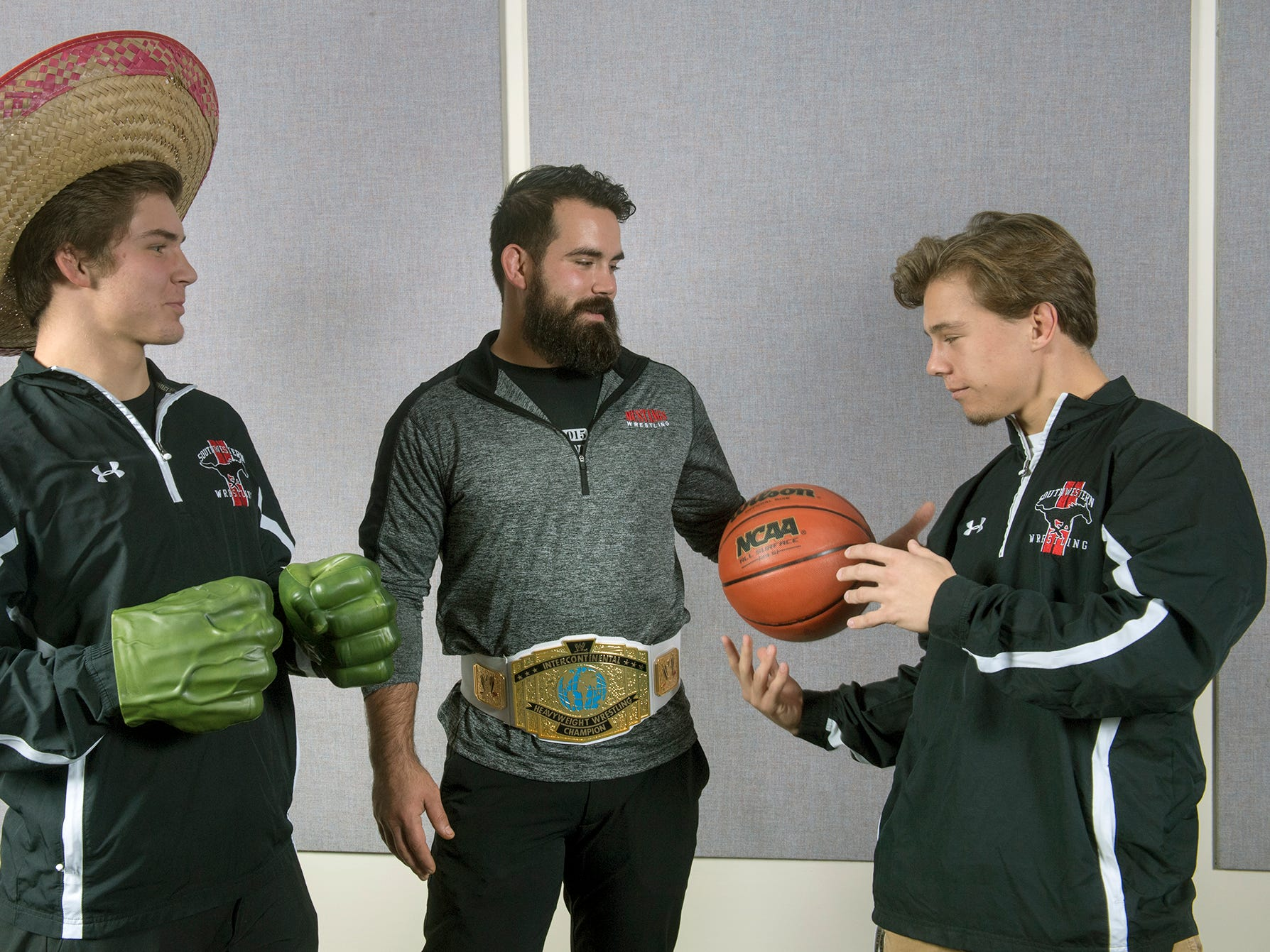 From the left, Ethan Baney, coach Nate Murren and Adam Leib, with the South Western wresting team, pose during the 2018-19 GameTimePa YAIAA Winter Media Day Sunday November 11, 2018.