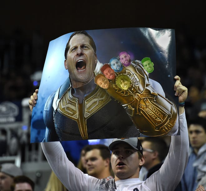 A Wolf Pack fan holds up a poster during Nevada's game last week against Pacific.