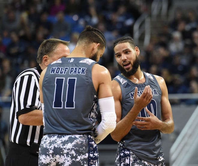 Nevada's Cody Martin (11) and Caleb Martin talk during a break in play last Friday against Pacific.