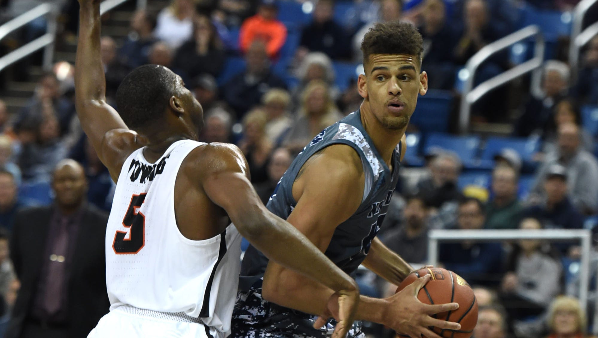 Nevada's Trey Porter looks t oget around Pacific's Anthoney Townes during Friday's game.