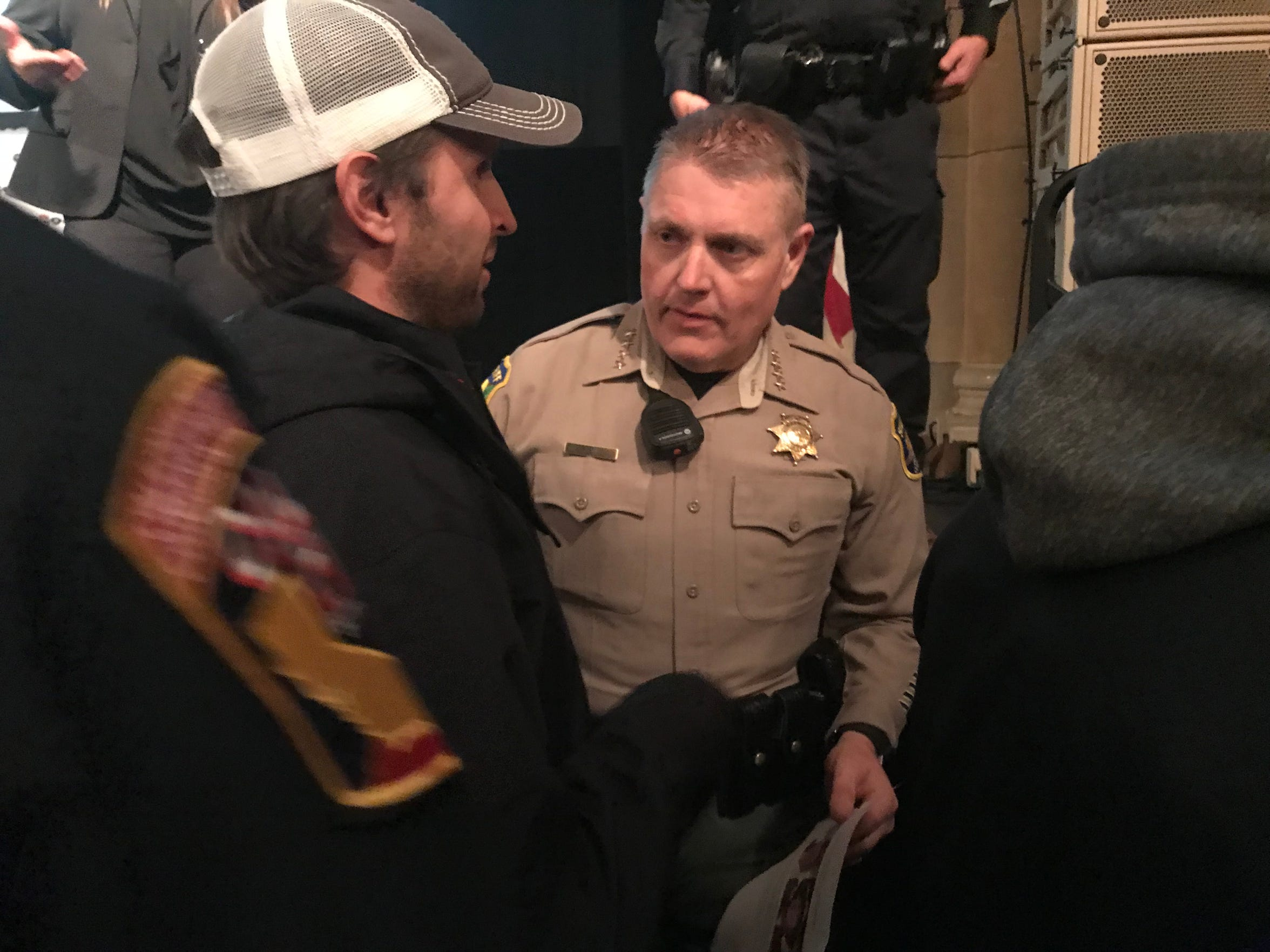 John Warner of Mi-Wuk Village, California, pleads Nov. 10, 2018, with Butte County Sheriff Kory Honea at a Camp Fire community meeting in Chico to help him find his missing grandparents.