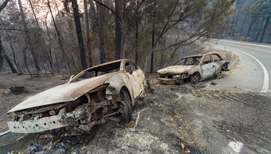 The Camp Fire swept through Paradise on Nov. 8, destroying buildings and cars.