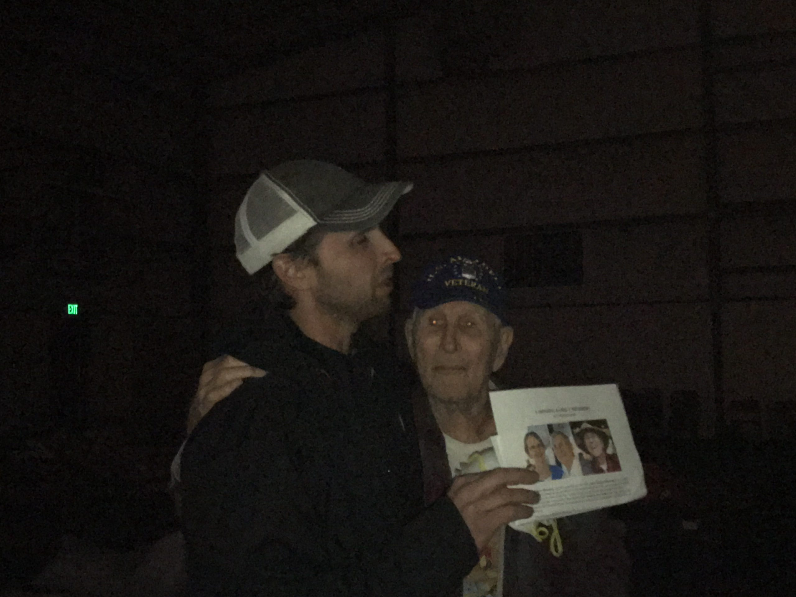 John Warner is overcome with emotion as he clutches the missing-persons flier his family made and embraces his grandpa Fay Sherman. The reunion happened late Saturday at Evangelical Free Church of Chico, a shelter for evacuees.