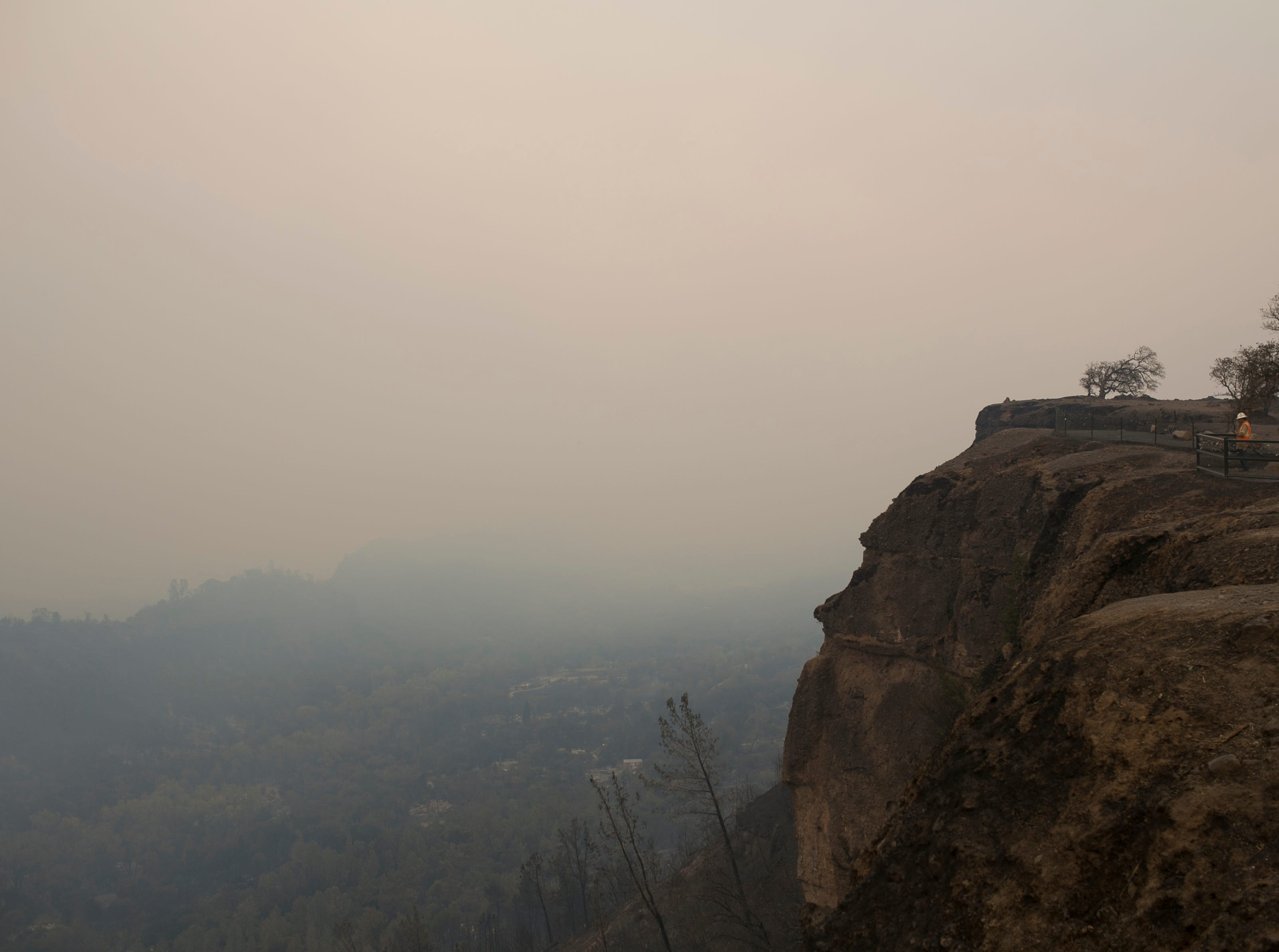 Smoke from the Camp Fire pours through a valley on Nov. 11, in Paradise, Calif.