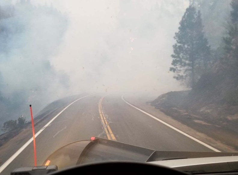 Smoke fills the road near the Cresta Powerhouse above Oroville Monday morning.